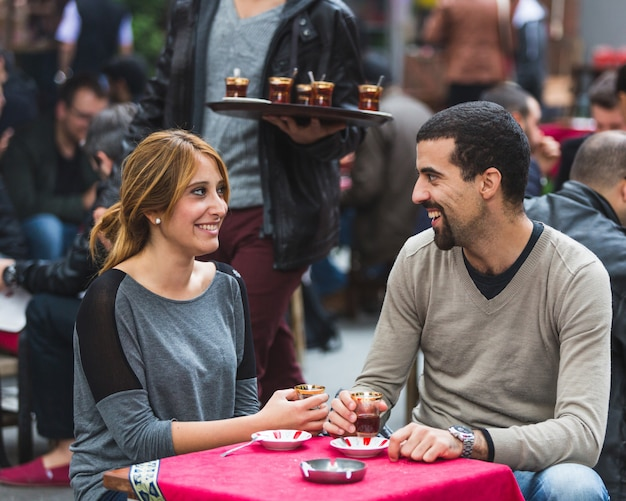 Turkish couple drinking cay, traditional tea, in istanbul Premium Photo