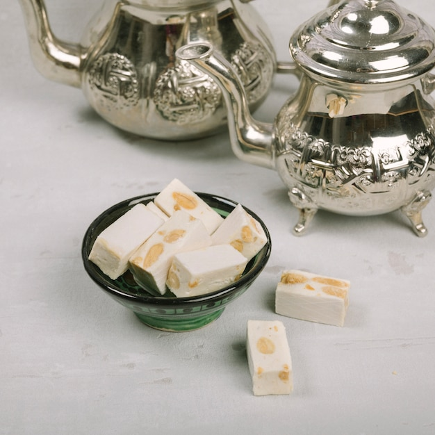 Turkish delight in bowl with teapots Free Photo