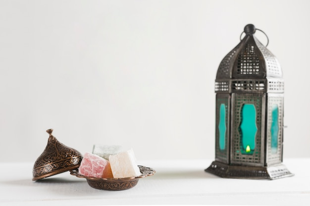 Turkish delight and candlestick Free Photo