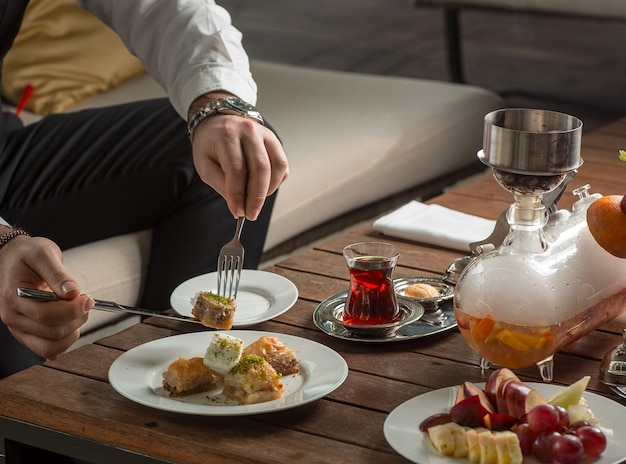 Turkish delight with black tea on the table Free Photo