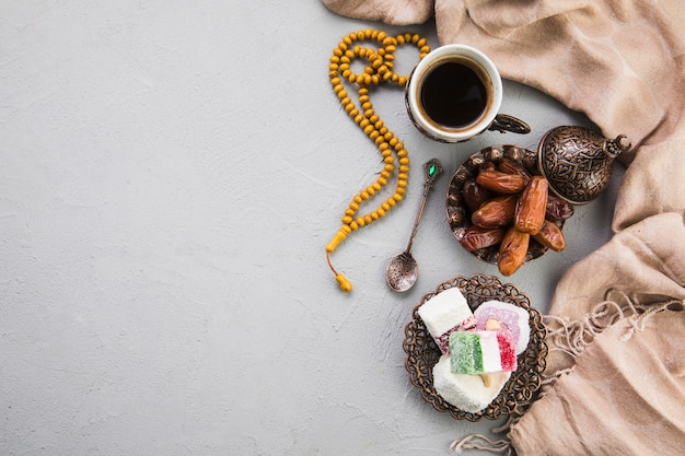 Turkish delight with coffee cup and dates fruit Free Photo