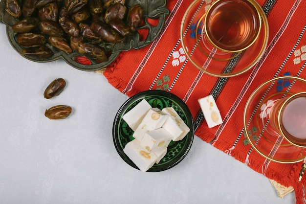 Turkish delight with dates fruit and tea Free Photo