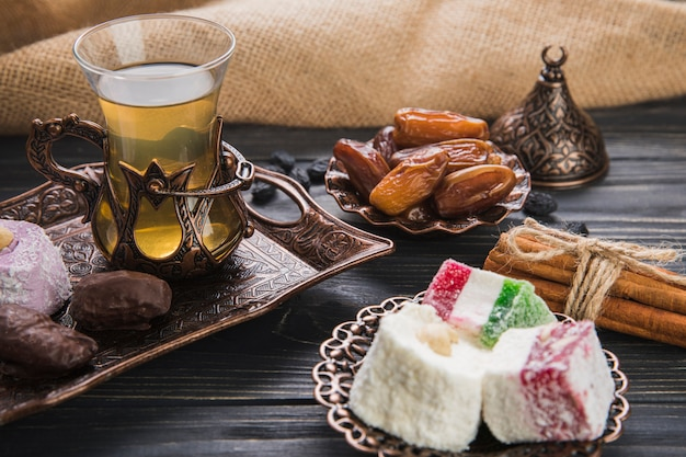 Turkish delight with tea and dates fruit Free Photo