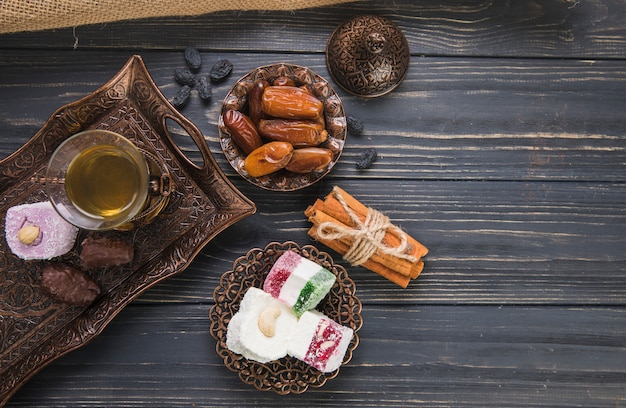 Turkish delight with tea glass and dates fruit Free Photo