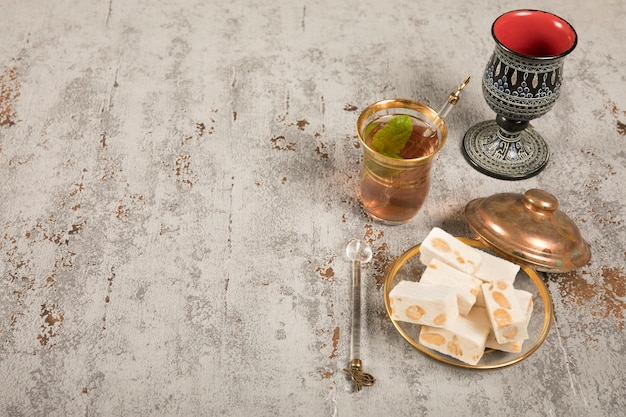 Turkish delight with tea glass on table Free Photo