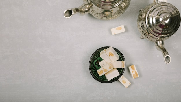 Turkish delight with teapots on table Free Photo