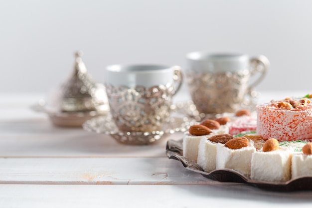 Turkish delight on a wooden surface table Premium Photo