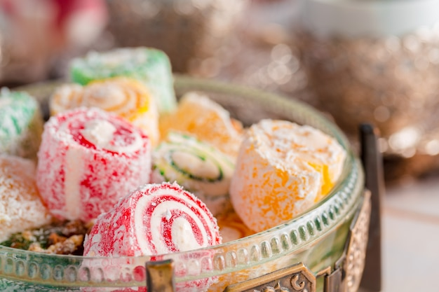 Turkish delight on a wooden table Premium Photo