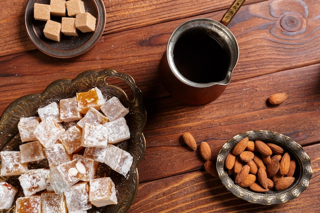 Turkish delight on a wooden table. Premium Photo