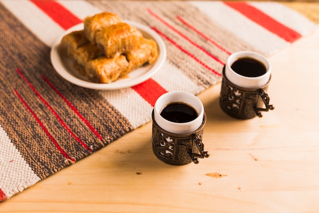 Turkish dessert with cups of coffee Free Photo
