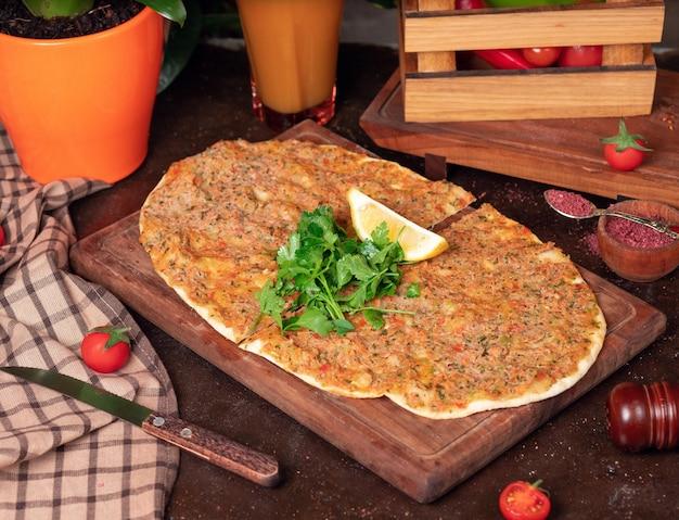 Turkish dishes: lahmacun, turkish pizzas, lemon, parsley Free Photo