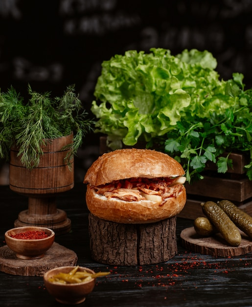 Turkish doner bun stuffed with grilled chicken and vegetables and served with turshu Free Photo
