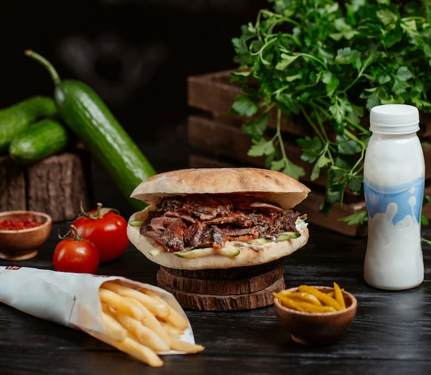 Turkish doner inside round bread with french fries and yogurt Free Photo