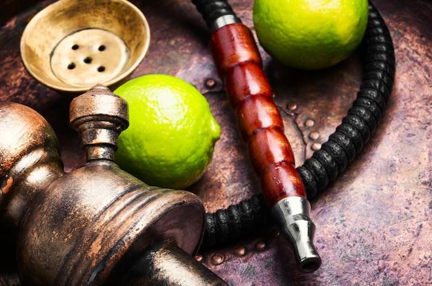 Turkish hookah with aroma lime Premium Photo