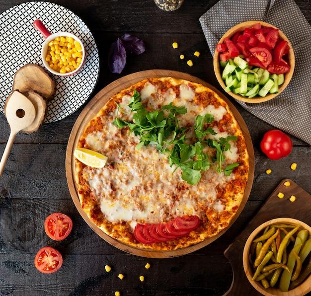 Turkish lahmajun with meat cheese greens and lemon Free Photo