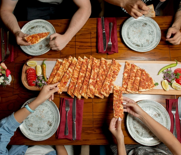 Turkish national lahmacun with vegetables Free Photo