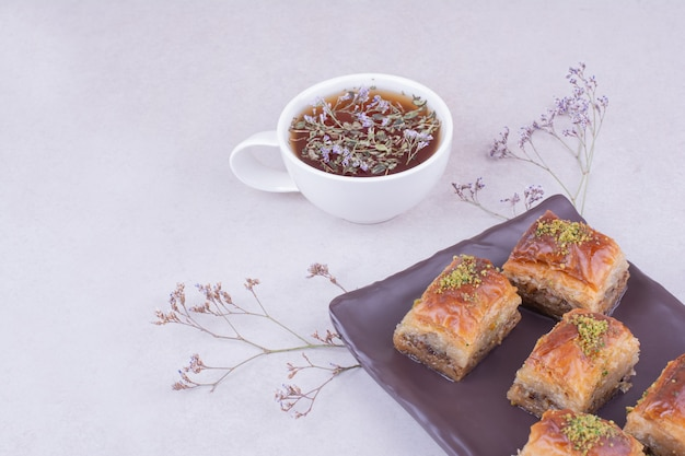 Turkish pakhlava with a cup of herbal tea Free Photo