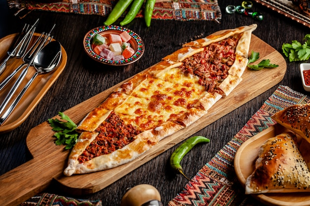 Turkish pizza pita with a different stuffing. Premium Photo