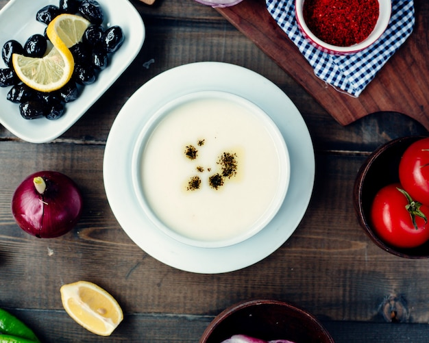 Turkish soup with ingredients on the table Free Photo