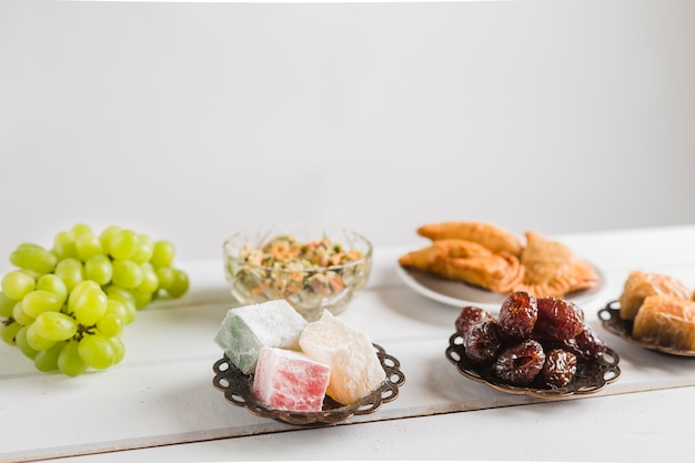 Turkish sweets and oriental dishes Free Photo