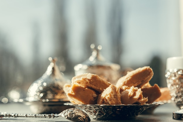 Turkish sweets with coffee on a wooden surface table Premium Photo