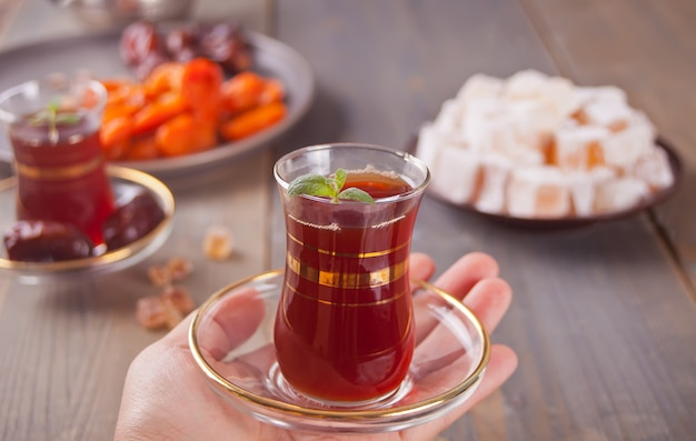 Turkish tea in traditional glass cups and turkish sweets Premium Photo