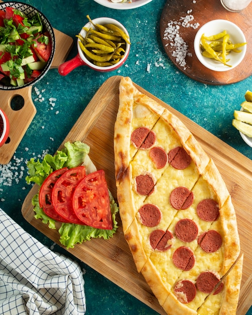 Turkish traditional pizza with sausage Free Photo