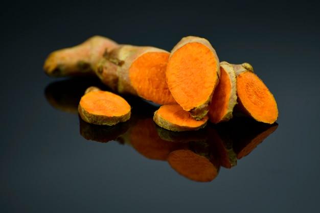 Turmeric (curcuma longa l.) root for alternative medicine, spa products and food ingredient. Premium Photo