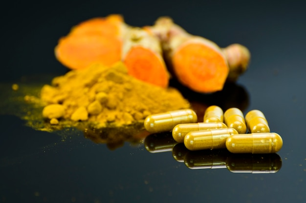 Turmeric (curcuma longa l.) root and turmeric powder for alternative medicine, spa products and food ingredient. Premium Photo