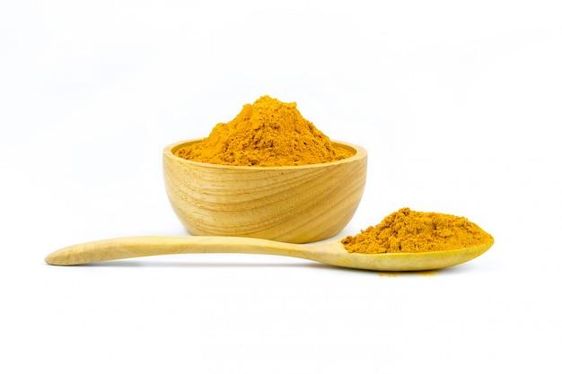 Turmeric powder and turmeric isolated on white background Premium Photo