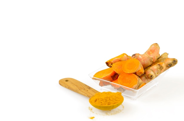 turmeric-roots-and-turmeric-power-on-whi
