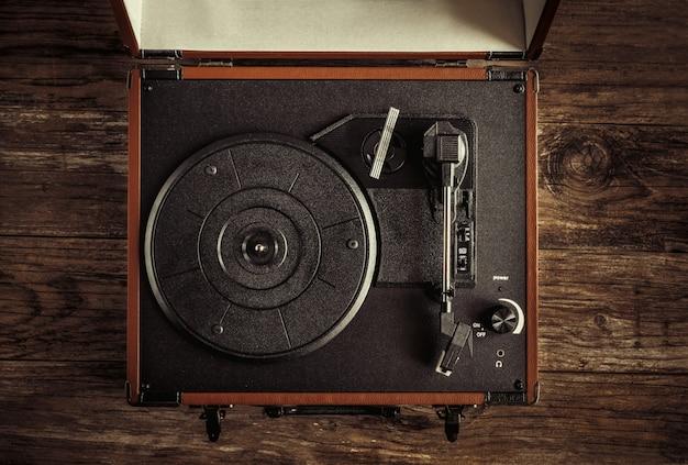 Turntable on old wood Premium Photo