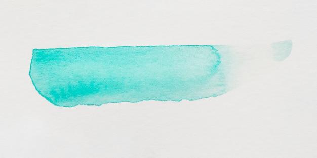 Turquoise brush stroke on white background Free Photo
