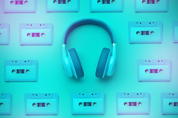 Turquoise headphones with audio cassettes Premium Photo