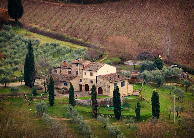 Tuscan landscape with cypress, trees and ancient buildings. Premium Photo