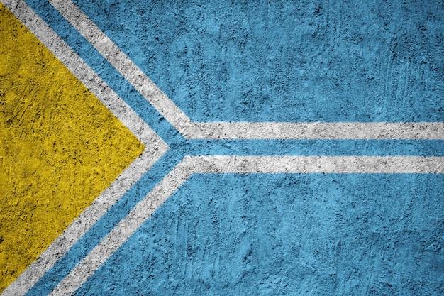 Tuva flag painted on grunge wall Premium Photo