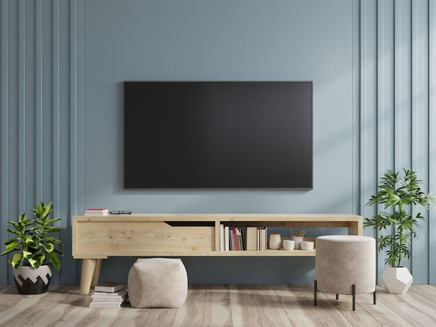 Premium Photo Tv On The Cabinet In Modern Living Room On Dark Blue Wall Background