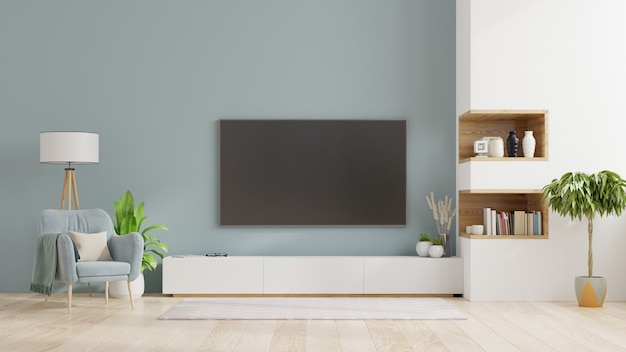 Premium Photo Tv On Cabinet In Modern Living Room Interior Of A Bright Living Room With Armchair On Empty Blue Wall