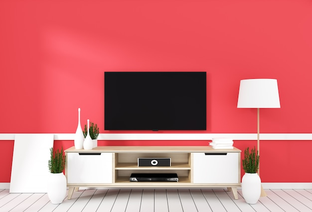 Tv on cabinet in modern living room with lamp,plant on red wall background Premium Photo