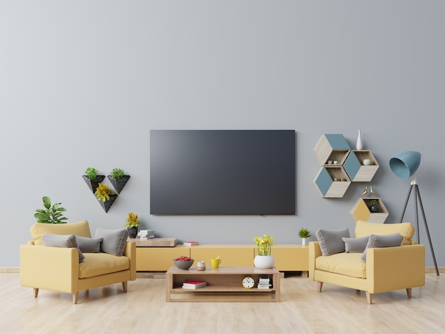 Tv on the cabinet in modern living room with yellow armchair on dark blue wall. Premium Photo