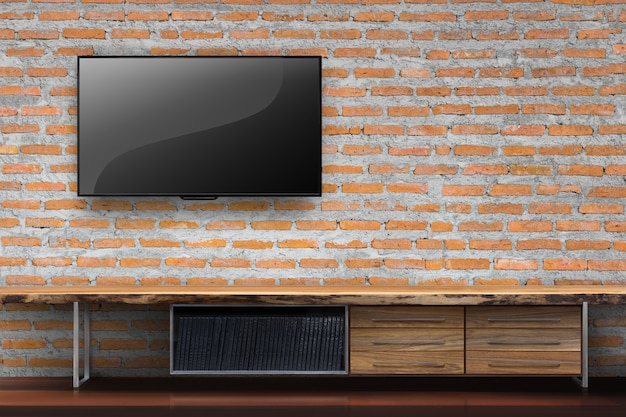 Red brick furniture Old Brick Tv On Red Brick Wall With Empty Wooden Table Media Furniture In Living Room Premium Photo Alamy Tv On Red Brick Wall With Empty Wooden Table Media Furniture In