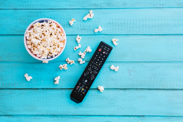 Tv remote control and popcorn Photo | Free Download