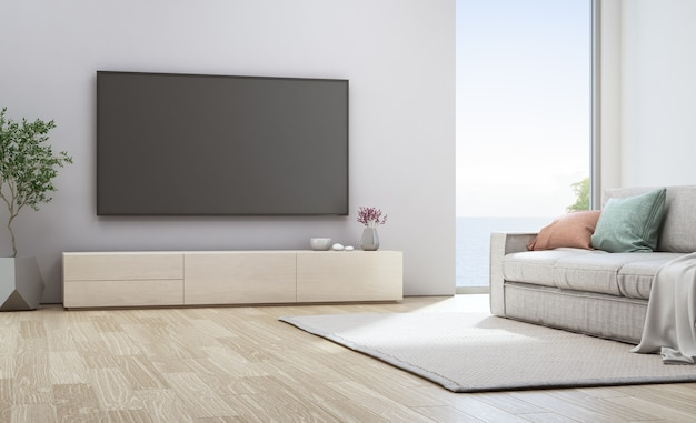 Tv on white wall near sofa in vacation home or holiday villa. hotel interior 3d illustrati Premium Photo