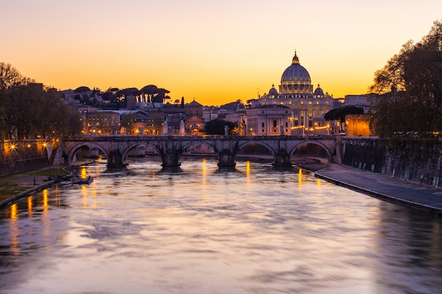 Twilight view of st. peter's basilica with tiber river in rome, italy Premium Photo