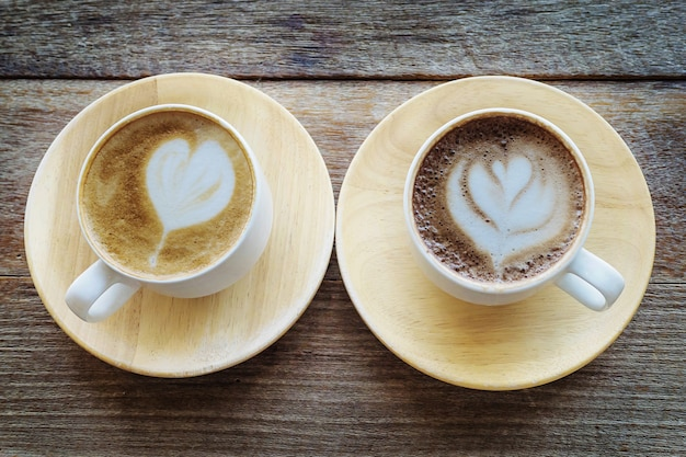 Twin coffee cup on old wooden table Free Photo
