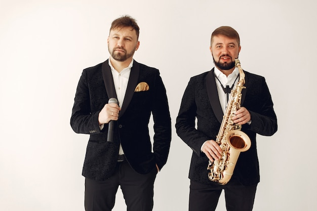 Two adult  musicians standing in studio Free Photo