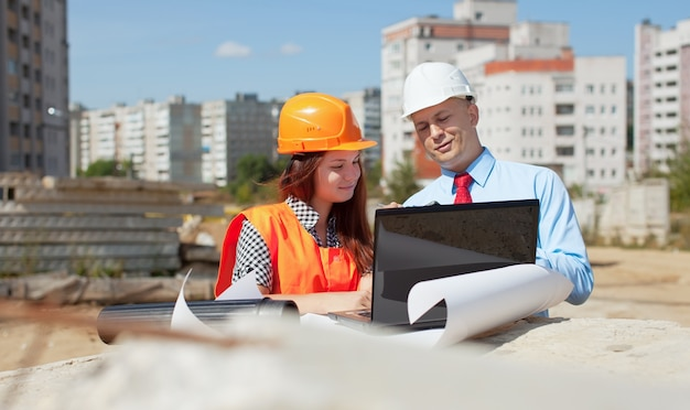 Two architects  in front of building site Free Photo