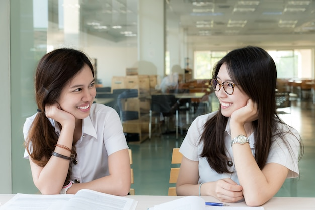Two asian student in uniform study in classroom. Premium Photo