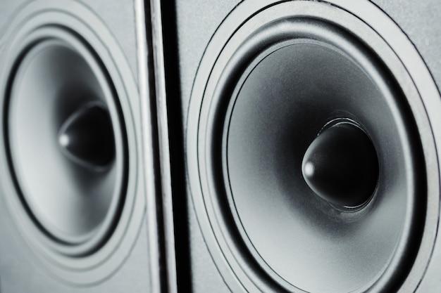 Two audio sound speakers on dark background, close up Premium Photo