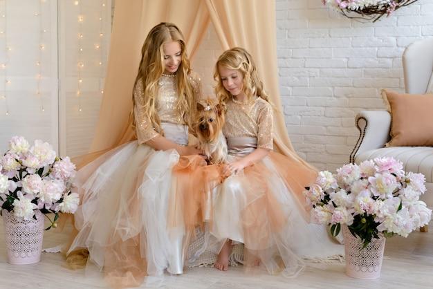 Two beautiful girls with a beautiful dresses Premium Photo
